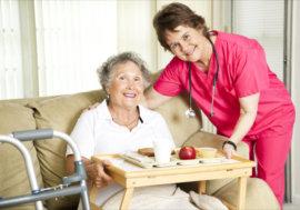nurse giving patient her food